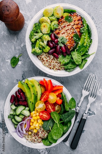 Foto auf Gartenposter Sortiment Healthy lunch Buddha bowls. Avocado, quinoa, red beans, spinach, avocado and fresh vegetables and with grilled chicken and grilled vegetables.