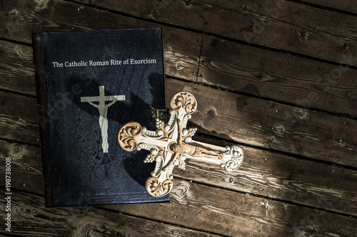 Photo exorcism book on wooden floor
