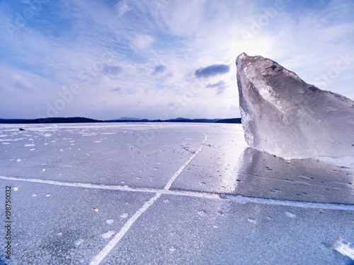 Fotografie, Obraz  Shining icebergs and ice floes, ice clefts reflected rays in the smooth water surface