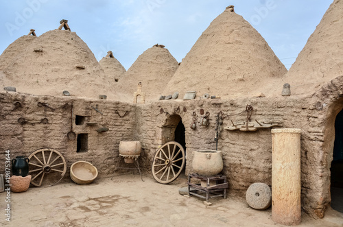 Deurstickers Midden Oosten Traditional beehive mud brick desert houses, located in Harran, Sanliurfa/Turkey. These buildings topped with domed roofs and constructed from mud and salvaged brick.