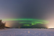 Northern lights on the horizon in Rovaniemi (Lapland, Finland)