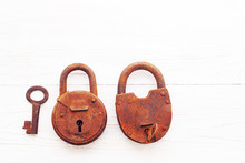 Two Old Rusty Padlock On Wooden White Background, Close Up