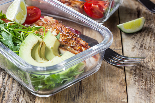 Deurstickers Assortiment Healthy meal prep containers with rukola, turkey grill, tomatoes and avocado
