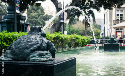 Famous frogs fountain spitting water in the city of Las Palmas, Gran Canaria island. Popular meeting point concept