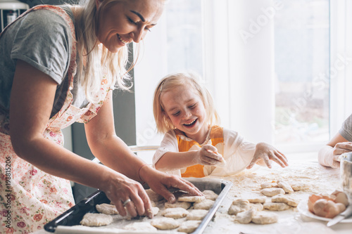 Poster Cuisine Mom cooking with daughter on the kitchen