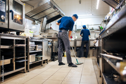 Fotografie, Obraz  assistant cleans in the kitchen