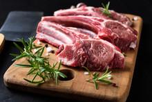 Raw Lamb Chops On A Wooden Cut...