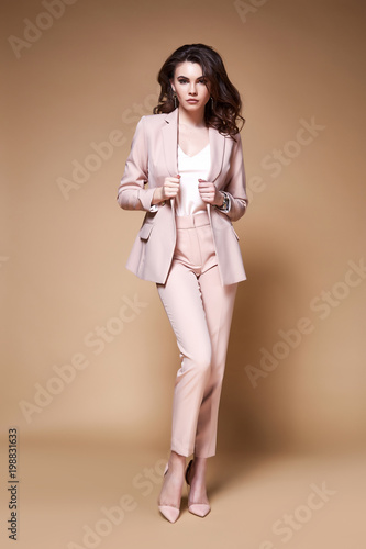 720b9a7080cde Sexy beautiful business woman lady boss CEO manager makeup long curly hair  brunette wear clothes office dress code suit jacket pants uniform work or  date ...