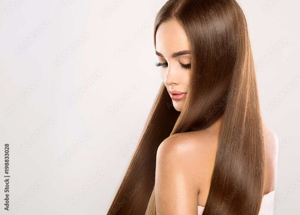 Fototapeta Beautiful model girl with shiny blonde straight long hair . Care and hair products .