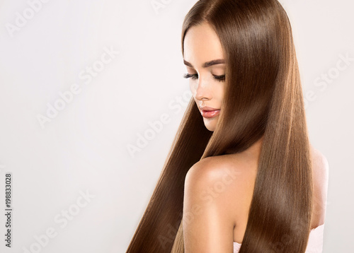 Foto Beautiful model girl with shiny blonde straight long hair