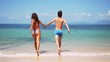 Young slim couple holding hands running into tropical sea on sunny day. slow motion. 1920x1080