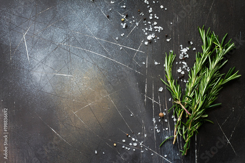 Spices and herbs on a dark stone or slate table. Ingredients for cooking. Food background. Copy space, top view flat lay background.