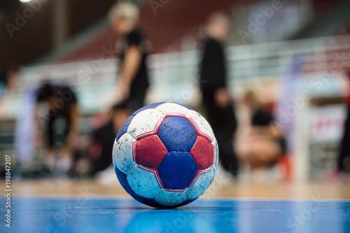 Obraz na płótnie Handball ball on court' s floor
