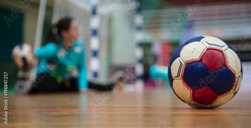 Fotografia, Obraz Handball ball on court floor