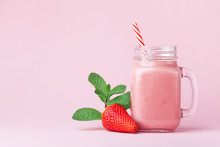 Strawberry Smoothie Or Milkshake In Mason Jar Decorated Mint On Pink Table. Healthy Food For Breakfast And Snack.