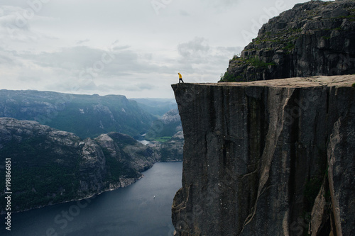 Foto op Canvas Zwart Nature photographer tourist standing on top of the mountain. Bea