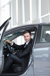 .successful businessman sitting behind the wheel of a new car