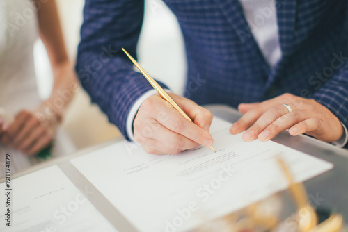 Fotografie, Tablou a painting of a man at a wedding, a hand with a pen signs a marriage document
