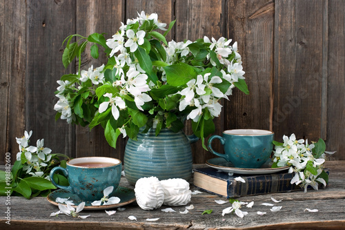 Composition with spring flowers, tea cup  and sweet zephyr