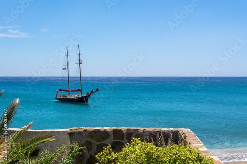 Keuken foto achterwand Schip View of ship on blue sea in Paleochori bay on Milos island in Greece.