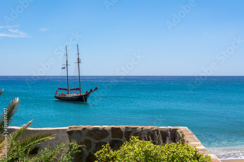 Foto op Aluminium Schip View of ship on blue sea in Paleochori bay on Milos island in Greece.