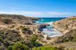 Kapros, small bay between rocks and blue sea on Milos island. Cyclades, Greece.