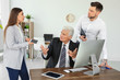 Office employees having argument at workplace