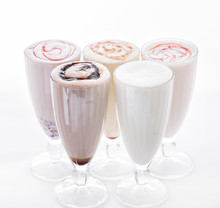 Five Ice Cream Shakes. Delicious Ice Cream Float, Vanilla, Strawberry, Coffee, Chocolate And White Background