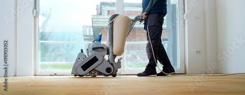 Fotografie, Obraz  Sanding parquet with the grinding machine