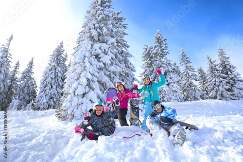 Garden Poster Winter sports Friends at snowy ski resort. Winter vacation
