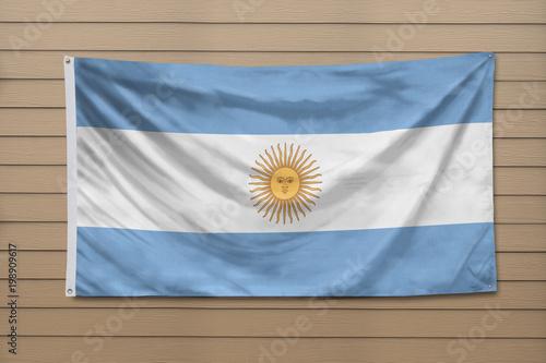 Fotografie, Obraz  Argentina Flag hanging on a wall