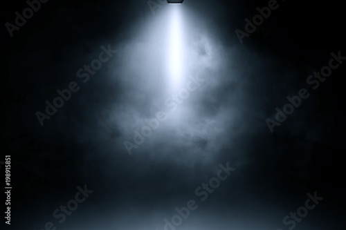 Fotobehang Licht, schaduw blue spotlight smoke studio entertainment background.