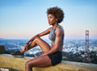 fit african woman woman resting on bench at runyon canyon shortly after sunset