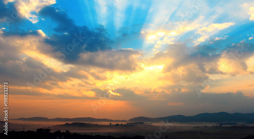 Fototapeta photography with silhouette panorama and landscape,morning with mist on sunrise so beautiful scene,sunset on hilltop with adventure and camping in vacation at Thailand obraz na płótnie