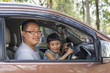 Asian or Thai father and daughter in the car