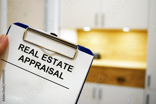 Man holding clipboard with Real estate appraisal. Wallpaper Mural
