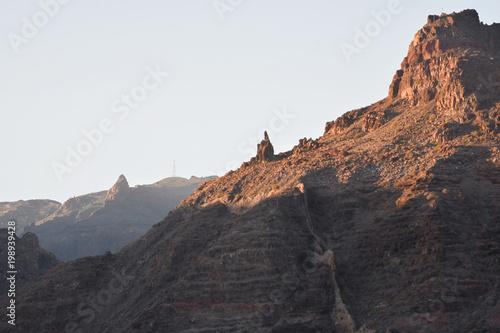 Fotobehang Grijs Look from the sea to the southeast coast of La Gomera