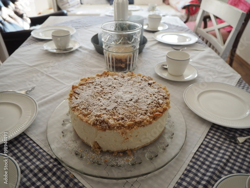 Birthday Cake On A Table With White Setting