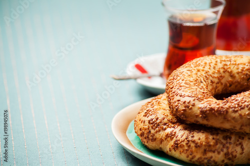 Turkish food: simit bread and cup of tea, shallow DOF
