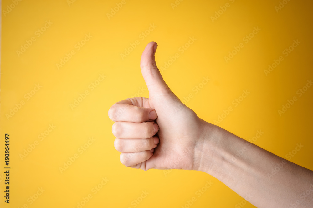 Fototapety, obrazy: emale hand showing thumbs up gesture