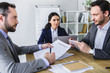 businesspeople working at table in modern office