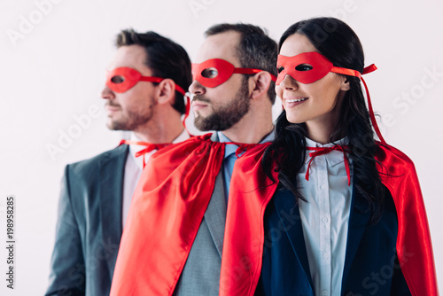 super businesspeople in masks and capes looking away in line in office Wallpaper Mural