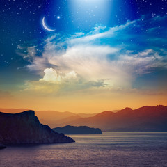 FototapetaRamadan Kareem background with crescent, stars and glowing clouds