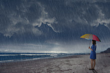 Young Asian Woman With Umbrella Looking At Ocean View