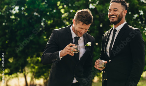 Fotografie, Obraz  Groom and best man drinking at wedding party