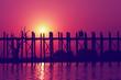 Leinwanddruck Bild - Sunset with silhouettes of monks on Bridge U-Bein teak bridge is the longest. in Amarapura ,Mandalay, Myanmar