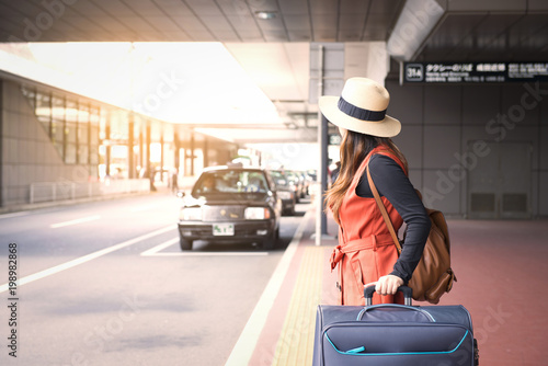 Fotografie, Obraz  Tourist is waiting a taxi in front of Tokyo airport in Japan.