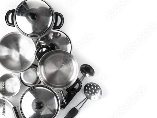 Set of stainless steel pot with kitchen tool set on white background,top view