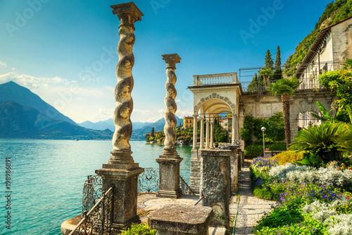 Mediterranean flowers and villa Monastero in background, lake Como, Varenna Tableau sur Toile