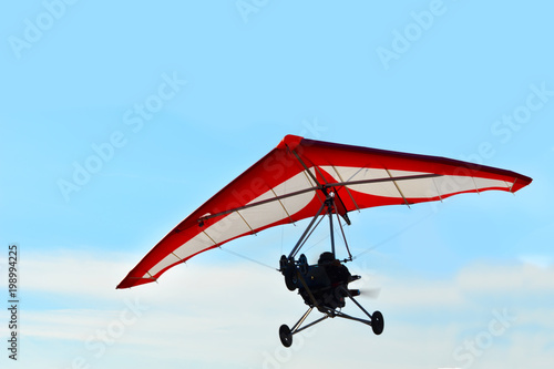 Canvas Prints Sky sports The motorized hang glider in the blue sky
